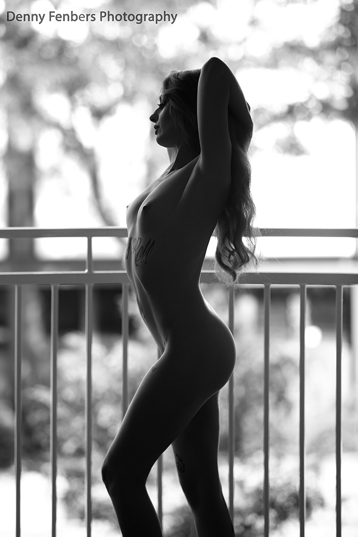 Nude stretch on Denver balcony